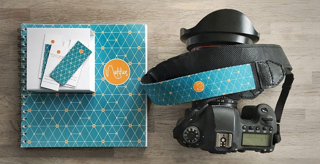 branded camera strap, notebook and business cards